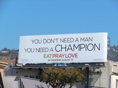 Билборд с рекламой фильма Ешь, молись, люби
