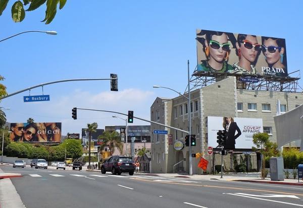 Билборды Prada и Gucci на одной улице